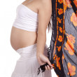 Pregnant woman with orange sarong — Stock Photo