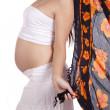 Pregnant woman with orange sarong — Stock Photo