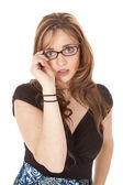 Woman with hand on glasses — Stock Photo