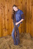 Woman with bridle smiling — Stock Photo