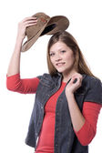 Woman putting on hat — Stock Photo