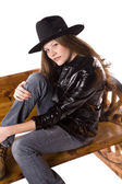 Woman with black jacket and hat on bench — Foto Stock