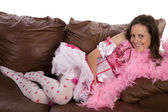 Laying on couch pink feathers — Stock Photo