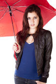 Woman Peaking Over Umbrella Smiling — Stock Photo