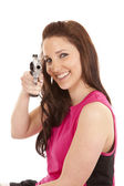 Woman in tanktop with gun smile — Stock Photo