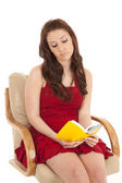 Woman red dress book sit reading — Stock Photo