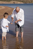 Boy learning to fish — Stock Photo