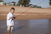 Boy fishing marina — Stock Photo