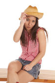 Cowgirl touch hat kiss — Stock Photo