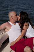 Kissing on boat bow — Stock Photo