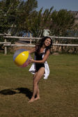 Woman beach ball grass smile — Stock Photo