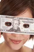 Greed eye hold money — Stock Photo