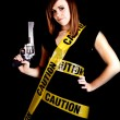 Woman caution gun — Stock Photo #29592445