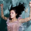 Woman in water back in dress — Stock Photo