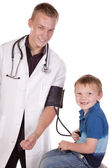 Doctor making boy happy — Stock Photo