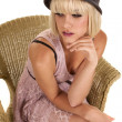 Woman purple dress hat sit — Stock Photo
