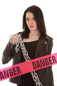 Danger woman with chain — Stock Photo