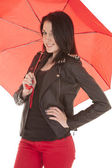 Woman red pants red umbrella — Stock Photo