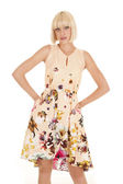 Woman light flower dress hands hips smile — Stock Photo