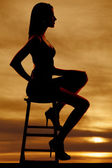 Silueta lateral vista mujer sentada — Foto de Stock