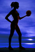 Silhouette volleyball hold in hand — Stock Photo