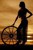 Silhouette woman lace skirt wagon wheel side — Stock Photo