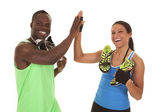 Fitness man woman with shoes high five — Stock Photo