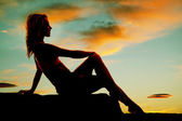 Silhouette of woman sitting looking to the right — Stock Photo
