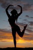 Silhouette woman fitness dance leg up — Stock Photo