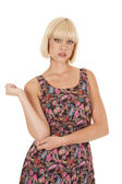 Woman paisley dress stand hand up — Stock Photo