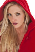 Woman red coat hood serious — Stock Photo