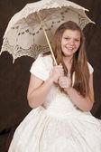 Girl white dress umbrella smiling — Stock Photo