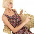 Stock Photo: Wompaisley dress sitting flower hold