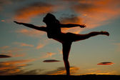Silhouette woman fitness yoga arm leg out — Stock Photo