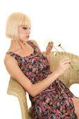 Woman paisley dress sitting flower hold — Stock Photo