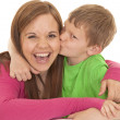 Girl and young boy kiss her laugh — Stock Photo #30105763