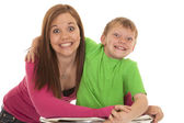 Girl and young boy both smile — Stock Photo
