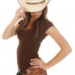 Western woman brown shirt look down touch hat — Stock Photo #30270597