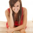 Woman red dress sit lean forward — Stock Photo #30270801