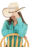 Woman western green shit chair look down — Stock Photo