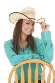 Kvinna västra grön skjorta stol ser — Stockfoto
