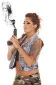 Woman tattoos gun angle side look down — Stock Photo