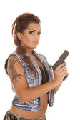 Woman tattoos gun looking serious side — Stock Photo