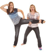 Two girls one leg up — Stock Photo