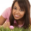 Woman golf pink shirt grass pink ball — Stock Photo