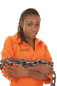 Woman prisoner orange chained up — Stock Photo