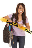 Woman shopper pull caution tape — Stock Photo