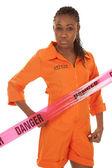 Woman prisoner orange danger — Stock Photo