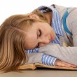 Stock Photo: School girl sleep on book