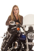 Woman blond sit motorcycle serious close — Stock fotografie